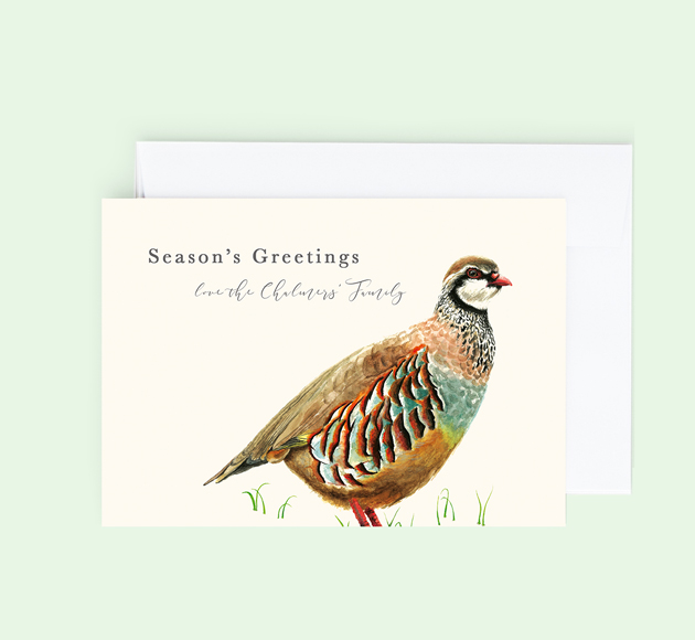 Customisable Christmas greeting card with a Partridge in the grass.