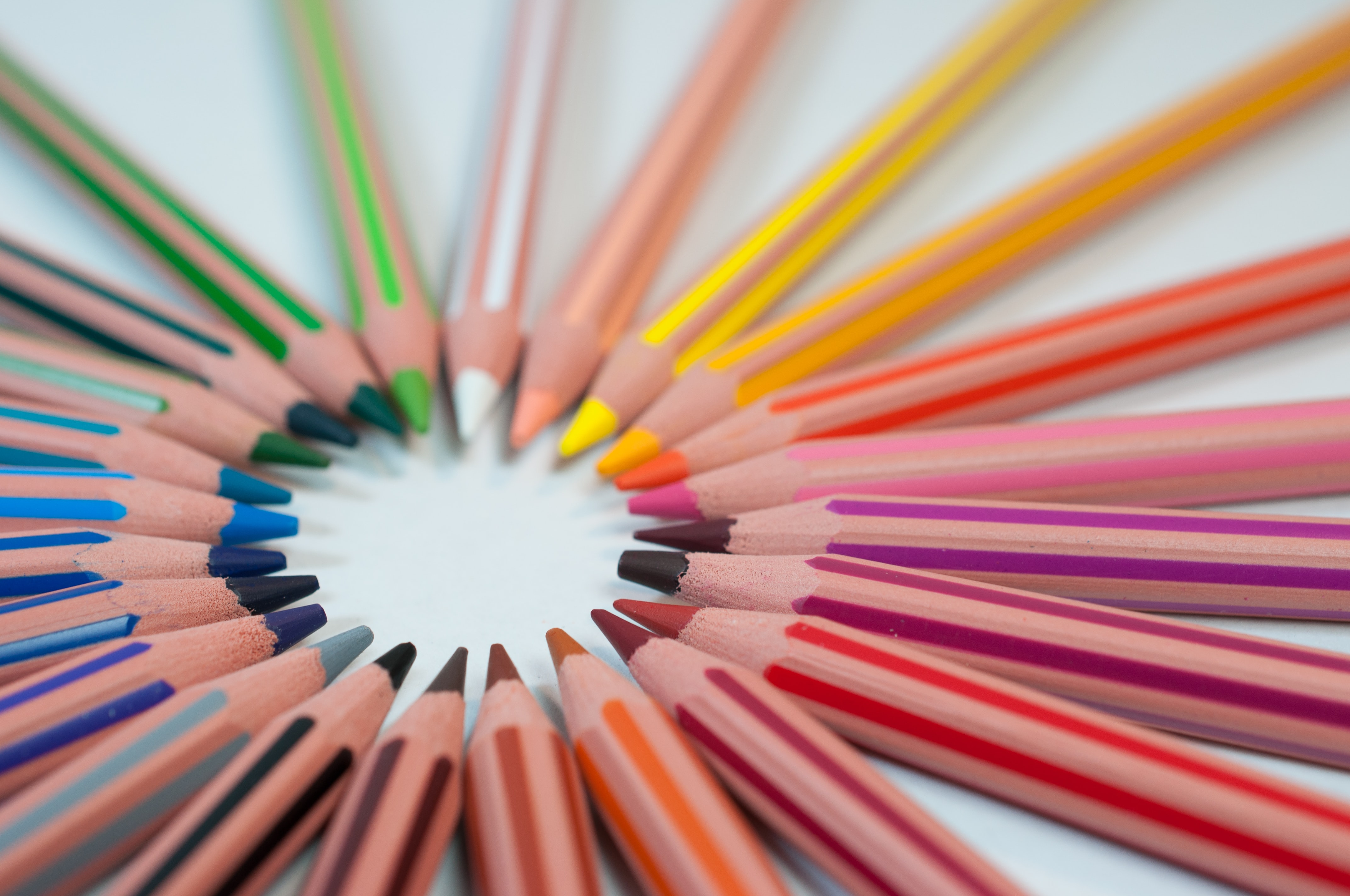 Back to school feature image with coloured pencils in a circle